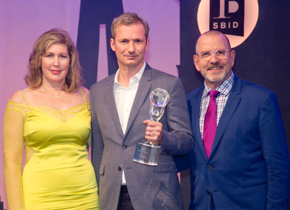 SBID Master of Design 2019, Chris Godfrey collecting his Award at the SBID International Design Awards 2019